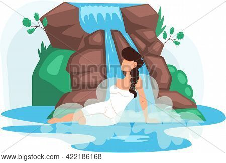 Girl Sits In Water In Lake Next To Rock And Waterfall. Clean Nature Concept, Tropical River And Beau