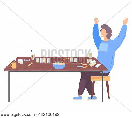 Man Won Game Joyfully Raises His Hands Up Near Table With Board Card Game. Guy Has An Interesting Ho