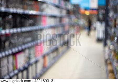 Abstract Blurred Shelving With Goods In A Retail Store In A Shopping Mall For Background