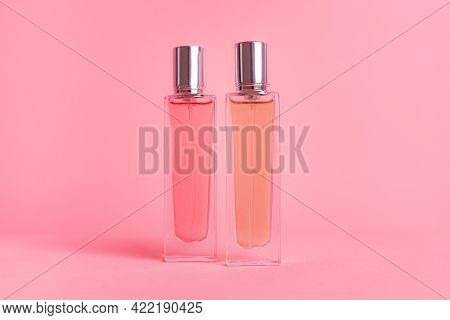 Perfume Bottles On A Pink Background . Aromatherapy. The Scent Of Perfume. The Choice Of Fragrance.