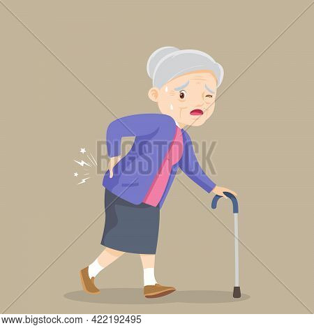 Elderly Woman Suffering From Back Pain. Old Woman With A Cane. Grandmother Suffering From Back Pain.