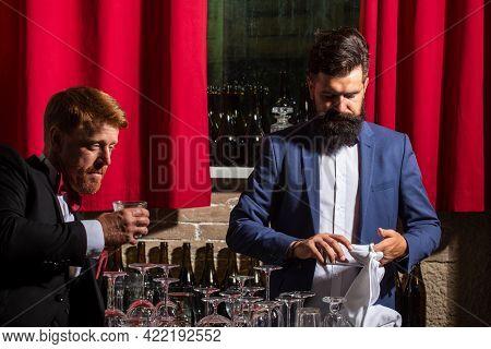 Bartender In Bar. Cocktail Serving. Alcoholic Drink. Bartender Wipes A Glass.