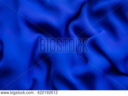 Blue Silk Texture Abstract Background. New Modern Design Luxurious Light And Soft Wave Smooth Shape