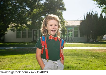 Child With Rucksacks In The School Park. Pupils With Backpacks Outdoors. Funny Nerd Kid.