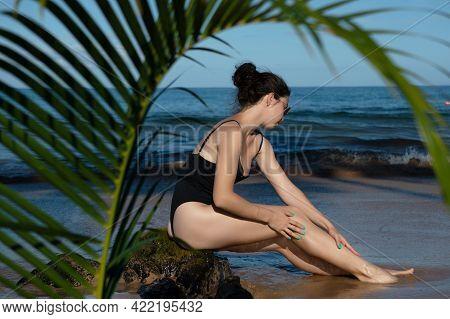 Relaxed Woman In Bikini Enjoying Tropical Beach And Summer Vacation. Fit Tanned Girl Enjoying A Walk