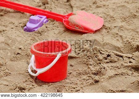 Children Toys In Sandbox. Plastic Bucket And Shovel, Playground For Kids