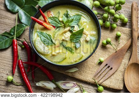 Chicken Green Curry Thai Food On Soup Bowl With Ingredient Vegetable Herbs And Spices Pepper Chili O