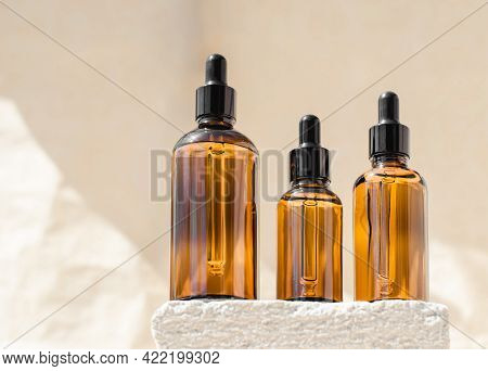 Natural Hyaluronic Serum In Bottles With A Pipette On A White Podium On A Beige Background. Natural