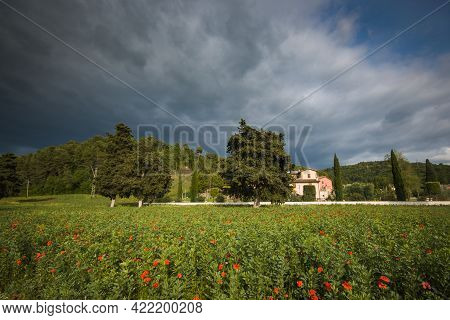 View Of Umbria Country With Red Poppies During Spring Season