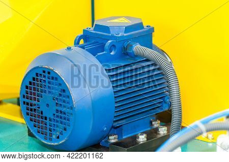 Powerful Electric Motor With Reducer. Electric Motor On Machine