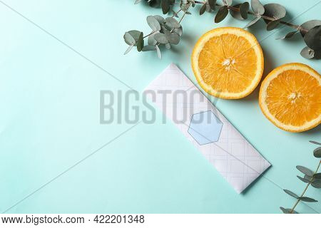 Scented Sachet, Eucalyptus Branches And Halves Of Orange On Turquoise Background, Flat Lay. Space Fo