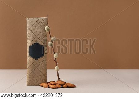 Scented Sachet, Pussy Willow Branch And Almonds On Grey Table Against Brown Background, Space For Te