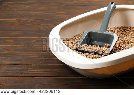 Cat Litter Tray With Filler And Scoop On Wooden Background, Closeup. Space For Text