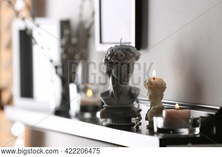 Beautiful David Bust Candles On Table Indoors