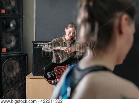 Rock Band Rehearsal. Studio Audio Check For A Female Band. Professional Musicians With Guitars. Smil