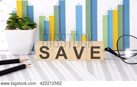 Save Word Written On The Wood Block With Chart, Glasses And Pencils