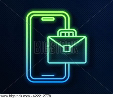 Glowing Neon Line Freelancer Icon Isolated On Blue Background. Freelancer Man Working On Laptop At H