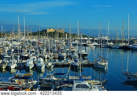 Many Yachts Of Different Sizes In The Port Of Vauban Against The Background Of Fort Carre. Antibes,