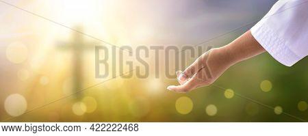 Help Concept: Hands Of God Over Blurred Autumn Sunset Background