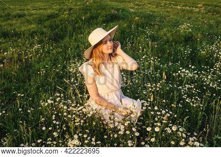 Beautiful Young Woman In Hat On Meadow.