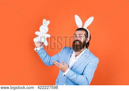 Bunny Hunt Begins. Happy Hipster With Beard. Man In Rabbit Ears. Preparation For Easter. Concept Of