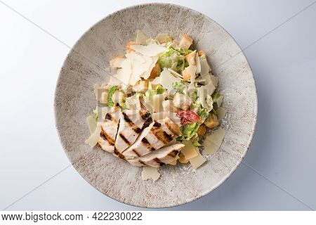 Healthy Organic Chicken Caesar Salad With Grilled Chicken On Plate