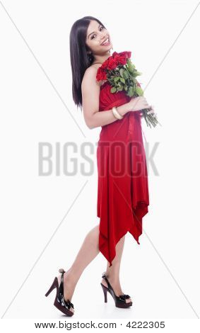 Beautiful Girl Standing With A Bouquet Of Red Roses