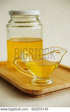 Freshly Made Liquid Homemade Ghee Butter Oil. Healthy Food Concept. Ayurveda Traditional Product