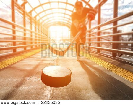 Close-up Of A Hockey Puck Of A Freestyle Hockey Player Playing Ice Hockey On Asphalt,the Moment Of H