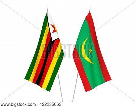 National Fabric Flags Of Zimbabwe And Islamic Republic Of Mauritania Isolated On White Background. 3