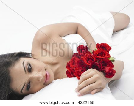 Asian Lady Of Indian Origin In Bed With Red Roses