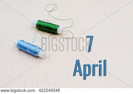 Handicraft Calendar 7 April. Skeins Of Green And Blue Threads For Embroidery On A Beige Background.