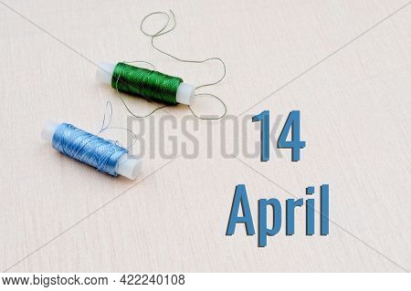 Handicraft Calendar 14 April. Skeins Of Green And Blue Threads For Embroidery On A Beige Background.