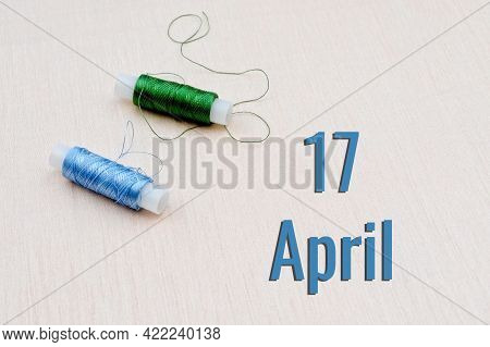 Handicraft Calendar 17 April. Skeins Of Green And Blue Threads For Embroidery On A Beige Background.