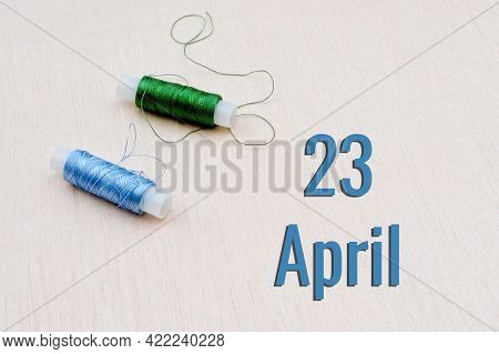 Handicraft Calendar 23 April. Skeins Of Green And Blue Threads For Embroidery On A Beige Background.
