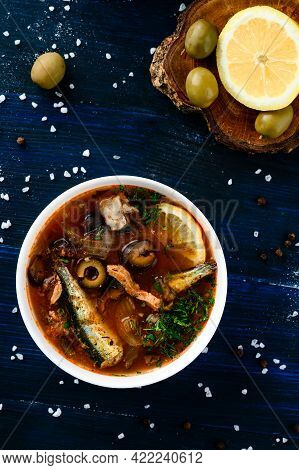 Solyanka, Russian Soup With Fish, Olives And Sour Cream
