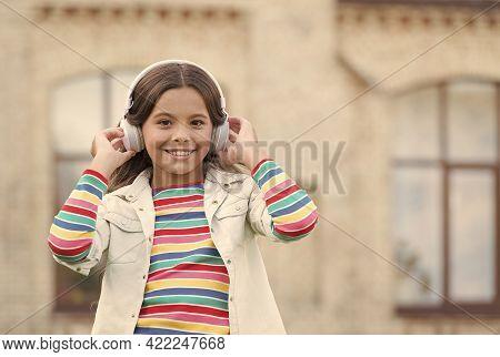 Modern Look Of Schoolgirl. Happy Kid In Headset. Pupil Listen Energetic Music. Back To School. Happy