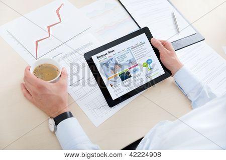 Businessman Reading Latest News