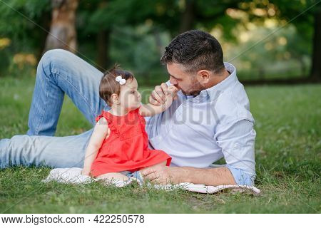 Fathers Day Holiday. Middle Age Caucasian Proud Father Playing With Baby Daughter. Family Dad And Da