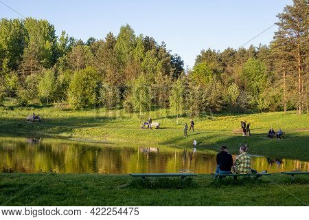 Vilnius, Lithuania - May 26, 2021: People Relax Around The Glacial Seskiukas Lake In Seskines Ozas P