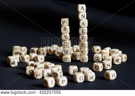 Turrets Made Of Cubes With The Word Psychoanalysis. Dark Background. The Concept Of Human Mental Pro