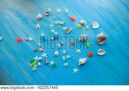 Seashells Summer Background. Many Different Seashells, Starfish On A Background Of Turquoise Shimmer
