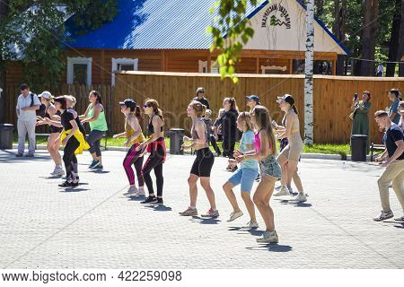 Yekaterinburg, Russia - 29.05.2021: Group Of Women Performing Zumba Dances In City Park, Fitness. Pe