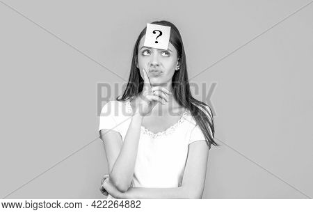 Confused Female Thinking With Question Mark On Sticky Note On Forehead. Paper Notes With Question Ma