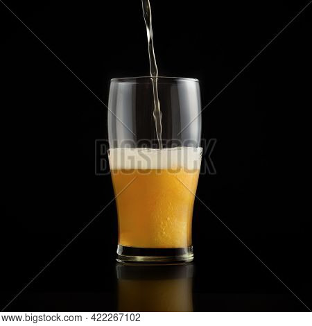 Light Draft Cold Beer Pour In Glass From Crane In Pub. Minimalistic Ad