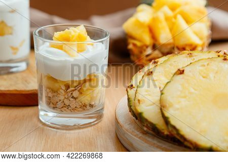Delicious Pineapple Dessert. Breakfast Dessert With Oat Granola, Greek Yogurt And Pineapple In Layer