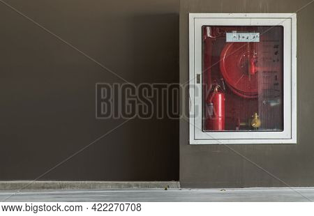 A White Fire Fighting Equipment Cabinet Or Fire Extinguishing Cabinet Of Fire Protection Set On Brow