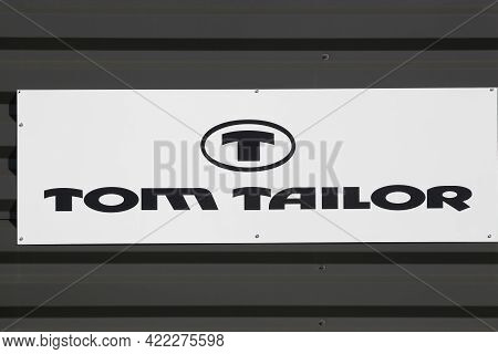 Macon, France - March 15, 2020: Tom Tailor Logo On A Wall. Tom Tailor Is A German Vertically Integra