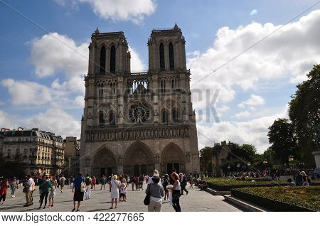 Notre Dame Cathedral. Summer Day In Paris. People In The Square In Front Of The Cathedral. Paris, Fr