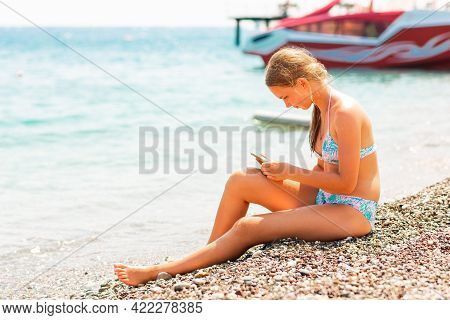 Teenage Girl Playing Games And Searching Web On The Telephone. Gadget Dependency Disorder Problem Fo